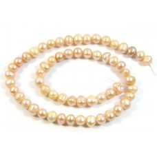 1 Strand Peach Potato Shape Freshwater Pearls approx. 5 mm.