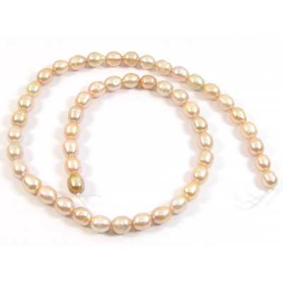 1 Strand Peach Rice Shape Freshwater Pearls approx. 7 mm.