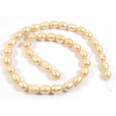 1 Strand Peach Rice Shape Freshwater Pearls approx. 10 mm.